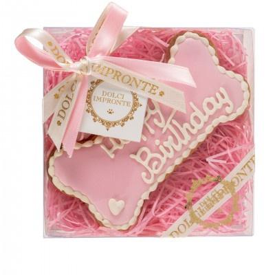 Torta di compleanno per cani a forma di osso rosa